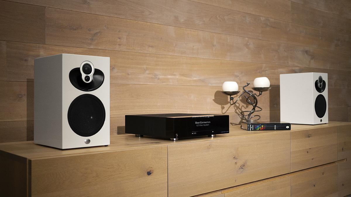 Black Majik DSM network music player and white Majik 109 speakers